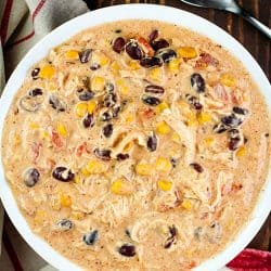 Fantastic and easy Crock Pot Cream Cheese Chicken Chili recipe in a white bowl.