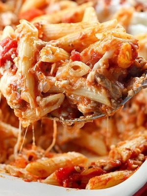 Skinny Cheesy Pasta Bake is a delicious layered casserole made lighter by using ground turkey and whole wheat pasta!