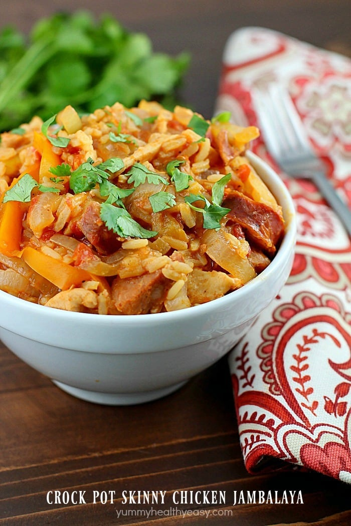 Crock Pot Skinny Chicken Jambalaya! Low calorie, tastes great and fills you up! Using lean proteins, (sliced chicken breasts and turkey sausage) sliced up onions and bell peppers, and rice mix and cooking it all in the slow cooker, makes this jambalaya recipe super easy. So tasty and with few ingredients!