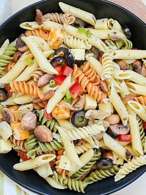 This unbelievable Best Ever Pasta Salad will be the hit of the picnic! Full of pasta, cheese cubes, pepperoni, olives and veggies and topped with a homemade dressing - this will be an instant favorite!