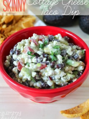 Bright red bowl filled with Cottage Cheese Taco Dip + 43 Healthy Snack Ideas
