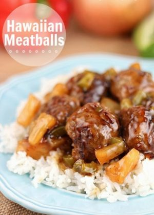 These Hawaiian Meatballs are made with a ground beef mixture that includes graham cracker crumbs, then cooked with an easy tangy sweet and sour sauce, pineapple tidbits and green peppers. 30 minute or less meal!