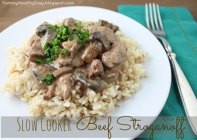White Plate with brown rice topped with Slow Cooker Beef Stroganoff