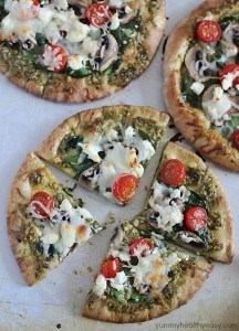 These Easy Pesto Pita Bread Pizzas use pita bread as the crusts and are spread with pesto and topped with veggies. Delicious and healthy lunch, dinner or snack!