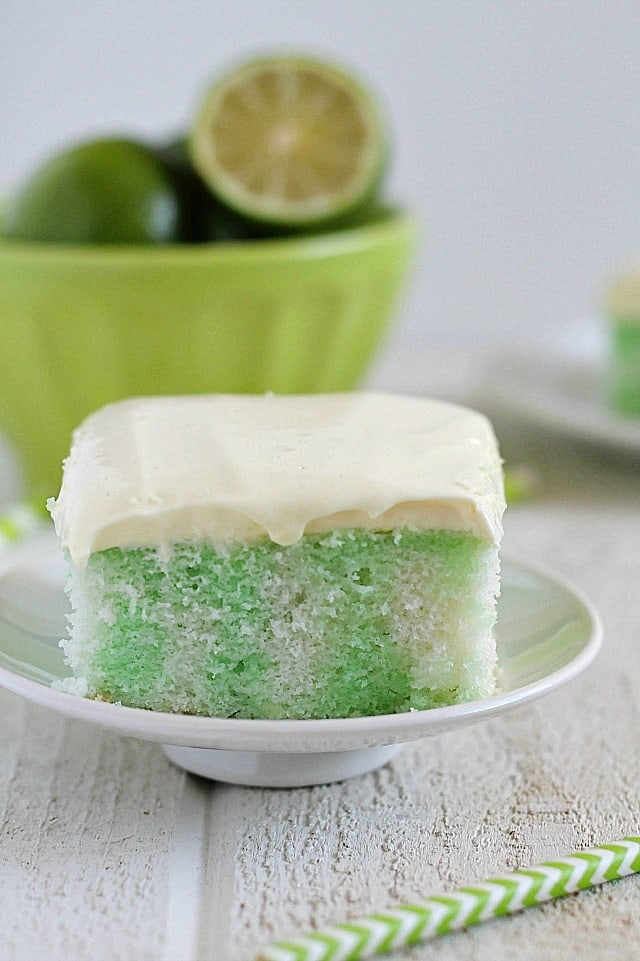 Skinny Lime Poke Cake recipe made using a white cake mix, two egg whites and diet lemon-lime soda. Then it's poked and poured over with sugar-free lime Jell-o and spread with a creamy pudding topping!