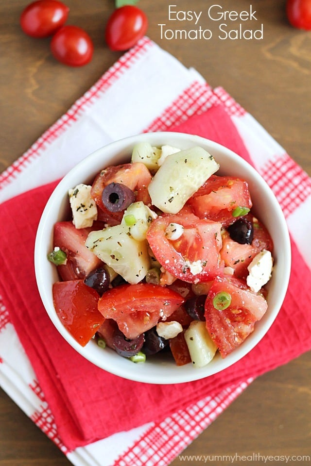 Greek Tomato Salad   easy salad made with tomatoes, cucumbers, olives, green onions & feta cheese and tossed with a homemade dressing. Light and delicious!