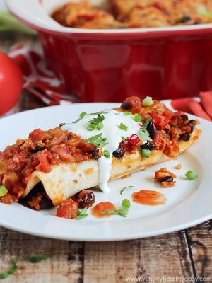 Healthy and delicious enchiladas with chicken, black beans and quinoa rolled inside flour tortillas. Guiltless and easy dinner!