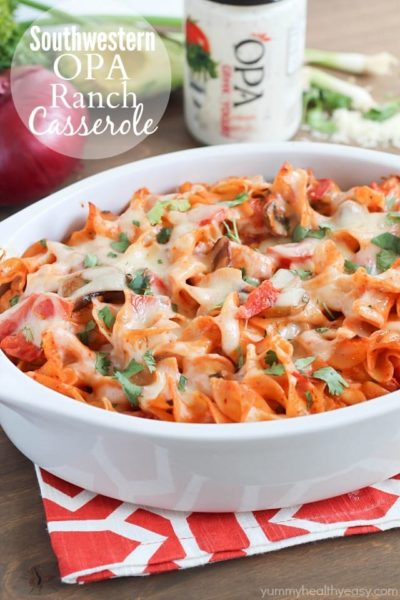 A delicious casserole with chicken, mushrooms, tomatoes and egg noodles tossed in a flavorful sauce made using enchilada sauce and OPA Greek Yogurt Ranch Dressing. Best casserole EVER!