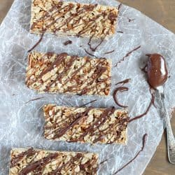 Top view of Easy No-Bake Granola Bars with oats, almonds and coconut with a delicious chocolate & Nutella drizzle on top + 43 Healthy Snack Ideas