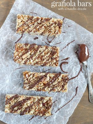 Easy No-Bake Granola Bars - simple granola bars with oats, almonds and coconut with a delicious chocolate & Nutella drizzle on top.