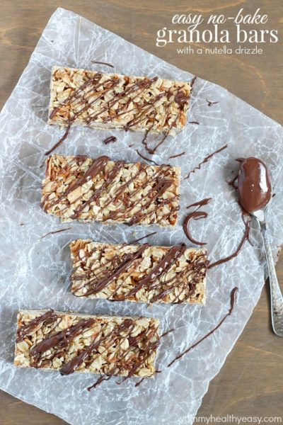 Top view of Easy No-Bake Granola Bars with oats, almonds and coconut with a delicious chocolate & Nutella drizzle on top.