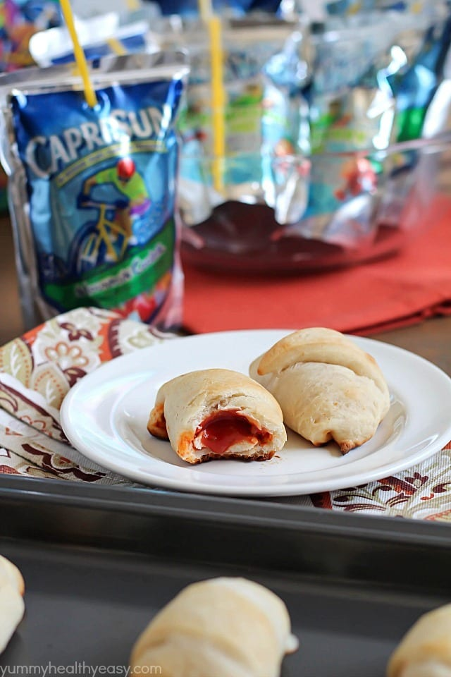 Simple & delicious Pizza Rolls made from ready-made pizza dough, mozzarella sticks, pizza sauce and pepperoni all rolled together in a fun little bite and served with a refreshing Capri Sun! #ad