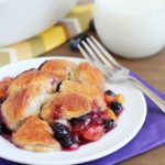 A quick and easy version of a classic cobbler by using refrigerated biscuits to create an easy topping over fresh peaches and blueberries. So delicious and EASY!