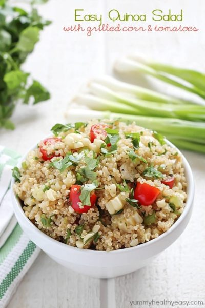 Quinoa Salad full of healthy quinoa, grilled corn, cherry tomatoes, cilantro and spices. Delicious!
