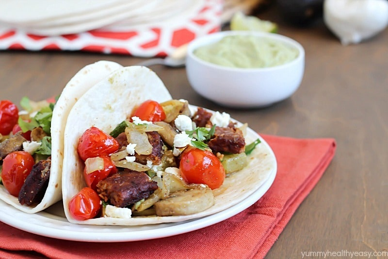 Roasted Vegetable & Black Bean Tacos served with Avocado Crema. Healthy, meatless and delicious! #ad #morningstarfarms