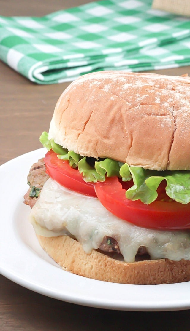 Flavorful Turkey Pesto Burger made with ground turkey, pesto, cilantro and green onions then topped with mozzarella and tomatoes - moist and delicious!