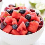 Watermelon Fruit Salad with cherries, blueberries and a delicious mint-lime dressing. Easy, fresh and the perfect summer side dish!
