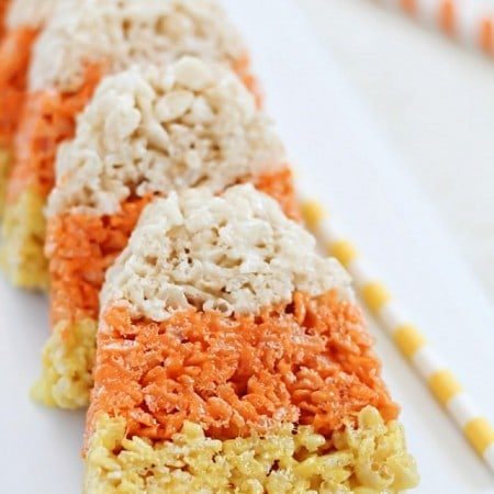 The cutest little Candy Corn Rice Krispie Treats make a fun Halloween snack and/or treat!