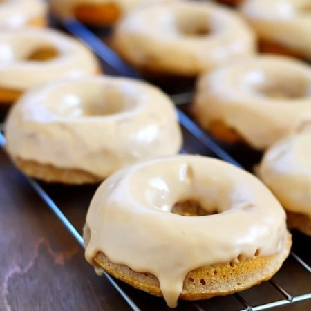 These Baked Apple Donuts with Maple Glaze are seriously the best baked donuts ever! Moist, apple-spiced flavor dipped in the tastiest maple glaze known to man. And only 196 calories per donut!
