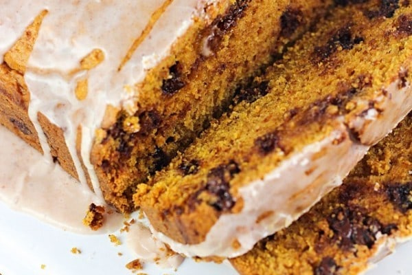 Chocolate Chip Pumpkin Loaf - so moist and delicious, with a spiced glaze drizzled over the top. Best pumpkin bread ever!