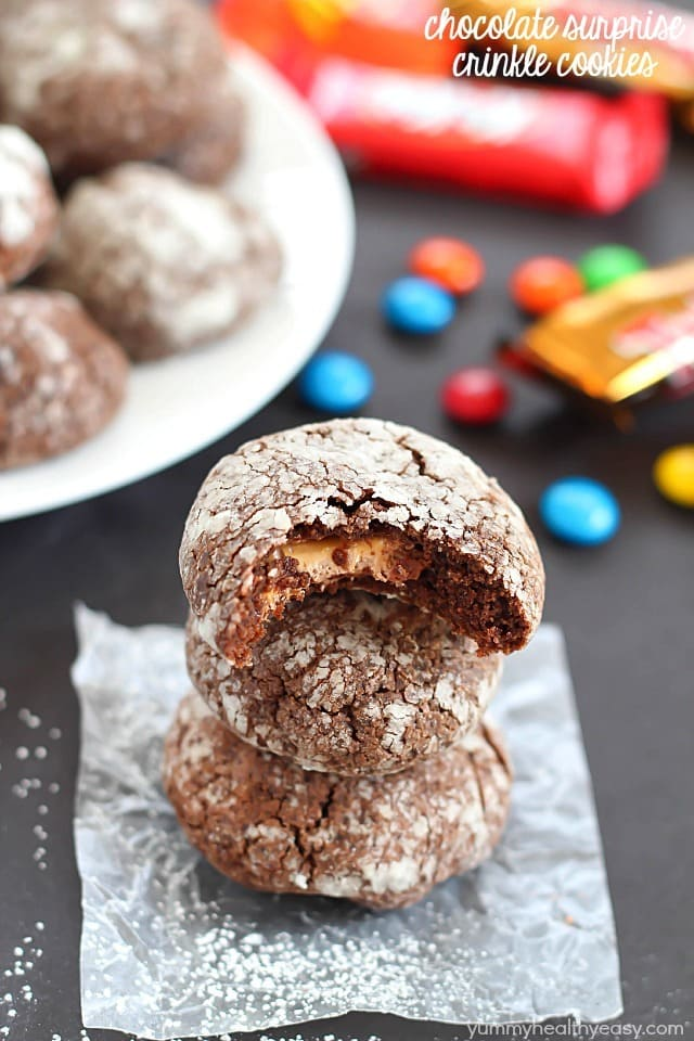 Chocolate Surprise Crinkle Cookies filled with pieces of your favorite candy inside and rolled in powdered sugar - the best way to use up any leftover candy!
