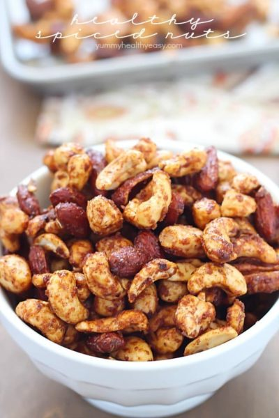 A white bowl overfilled with Healthy Spiced Nuts! Yum!