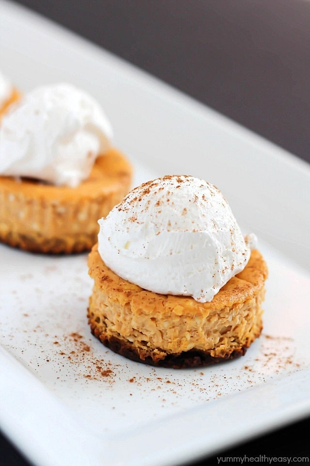 Perfect single-size Mini Pumpkin Cheesecakes full of soft, creamy, pumpkin yumminess and less than 160 calories per cheesecake! Best fall dessert yet!