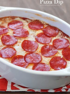 The most unbelievable pizza dip! A layer of herbed cream cheese, homemade sauce, cheese and then topped with pepperoni. AMAZING!