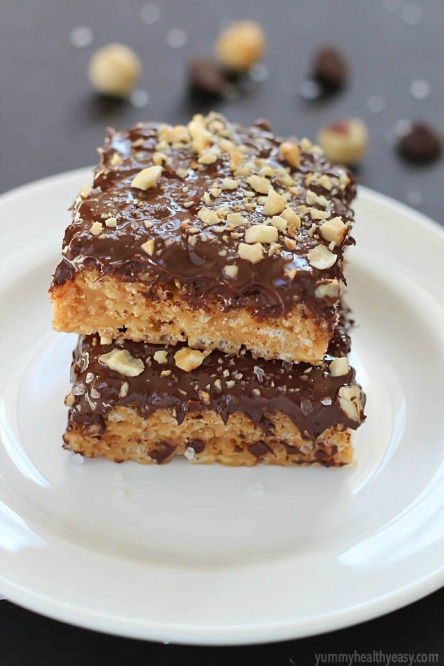 A layer of peanut butter Rice Kripsie treats topped with a layer of dark chocolate, hazelnuts and a little bit of sea salt. These scotcheroos will knock your socks off!