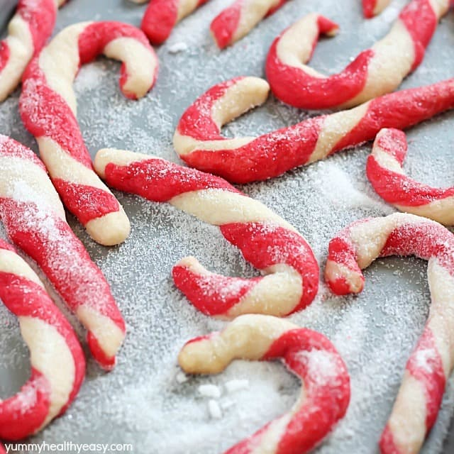 Get the whole family in the kitchen and make these adorable Candy Cane Cookies this holiday season! They're fun to make, super cute and totally delicious!
