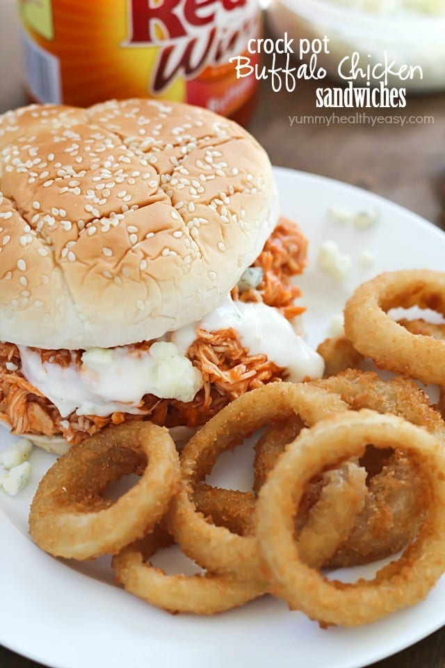 You will love these 3-ingredient Crock Pot Buffalo Chicken Sandwiches! Shredded buffalo chicken inside buns and smothered with blue cheese and hot sauce. So easy and absolutely delicious!