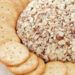A super easy cheese ball that's sure to impress any guests! It's creamy, tangy, irresistible and won't take more than a few minutes to whip up.