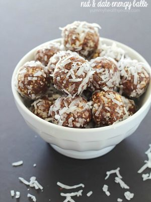 A white bowl full of No-Bake Nut & Date Energy Balls
