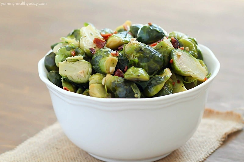 Need an easy side dish? This bacon brussels sprouts recipe is the way to go! They're fancy enough to serve as a side dish at a party but quick & easy enough to be added in with a weeknight meal.