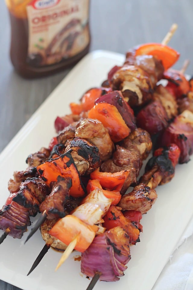 Delicious grilled shish kabobs with tender pork, mushrooms, red peppers, tomatoes and onions. The perfect game day or ANY day meal! #evergriller #ad