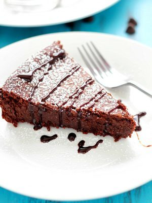 Flourless Chocolate Cake is made with a secret ingredient instead of flour... ;) The most incredible moist, fudgy, decadent cake that's incredibly light and crumbly all at the same time! Perfect Valentine's Day dessert! #truvia
