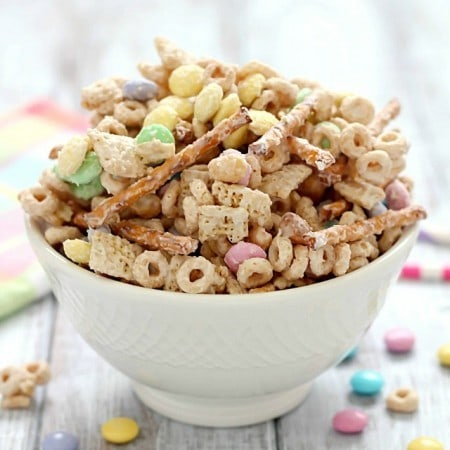 Super delicious and easy Bunny Bait aka Easter Snack Mix. Made with cereal, pretzels, peanuts, pastel M&M candies and white chocolate - perfect for Easter!