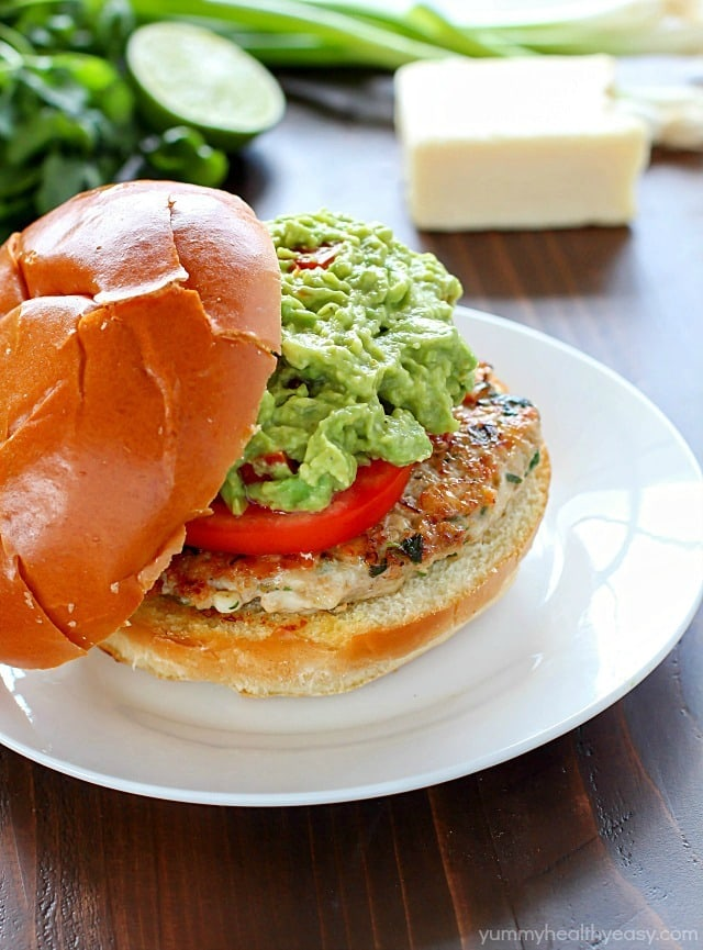 The juiciest, most delicious, guacamole chicken burgers! Super simple to make - serve on buns with a layer of guacamole on the top.  Amazing!