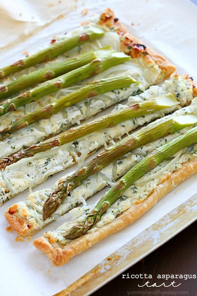 Ricotta Asparagus Tart - a crust of puff pastry, a filling of herbed ricotta, parmesan and romano cheeses, a layer of thinly sliced onions and topped with asparagus. Perfect for spring!!