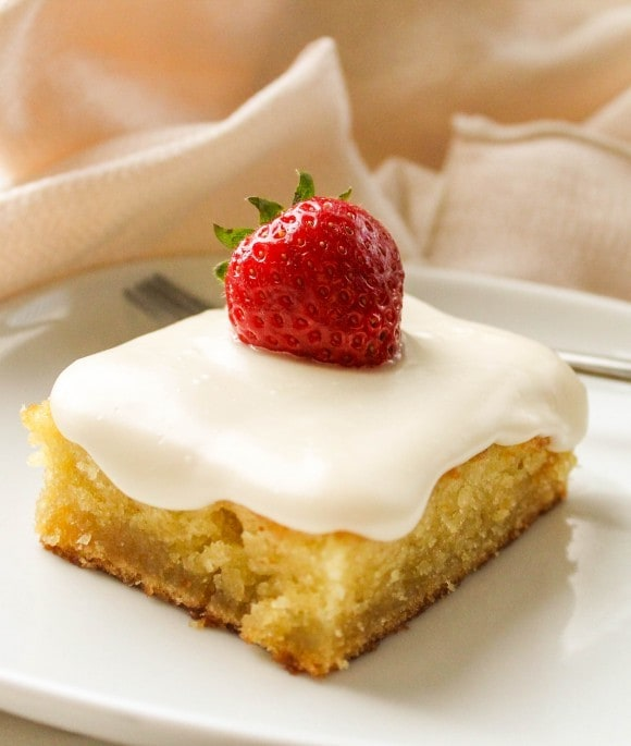 Coconut Almond Sheet Cake - Coconut is one of my favorite summer desserts.  This sheet cake looks out of this world delicious!