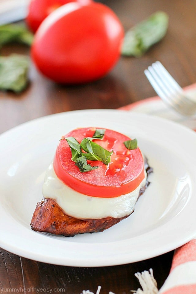 Easy Balsamic Chicken recipe with a caprese twist! Chicken breasts are cooked until tender in a flavorful balsamic sauce then topped with mozzarella, basil & tomato. Low carb and gluten free!