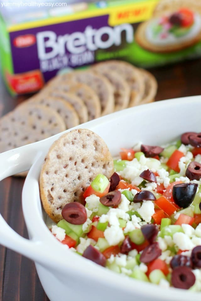Deliciously healthy greek dip, made with a protein-rich cottage cheese base (with ranch seasonings!) then topped with cucumbers, green onions, tomatoes, kalamata olives, and feta cheese. Healthy and full of flavor! #breton #ad