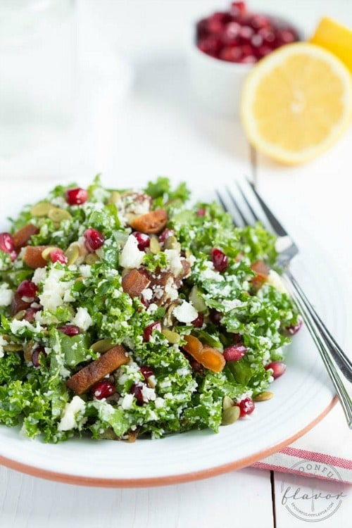 Cauliflower Kale Salad with Pomegranate, Dried Apricots & Pumpkin Seeds by Spoonful of Flavor