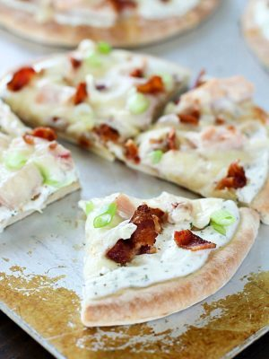 Bacon Ranch Chicken Pita Pizza on a cookie sheet, sliced up!