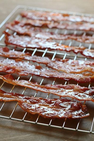 Brown Sugar Bacon aka Candied Bacon aka the Best Bacon EVER! This easy bacon is baked in the oven with a topping of brown sugar and pepper, and comes out sticky, sweet & savory. Absolutely drool-worthy!