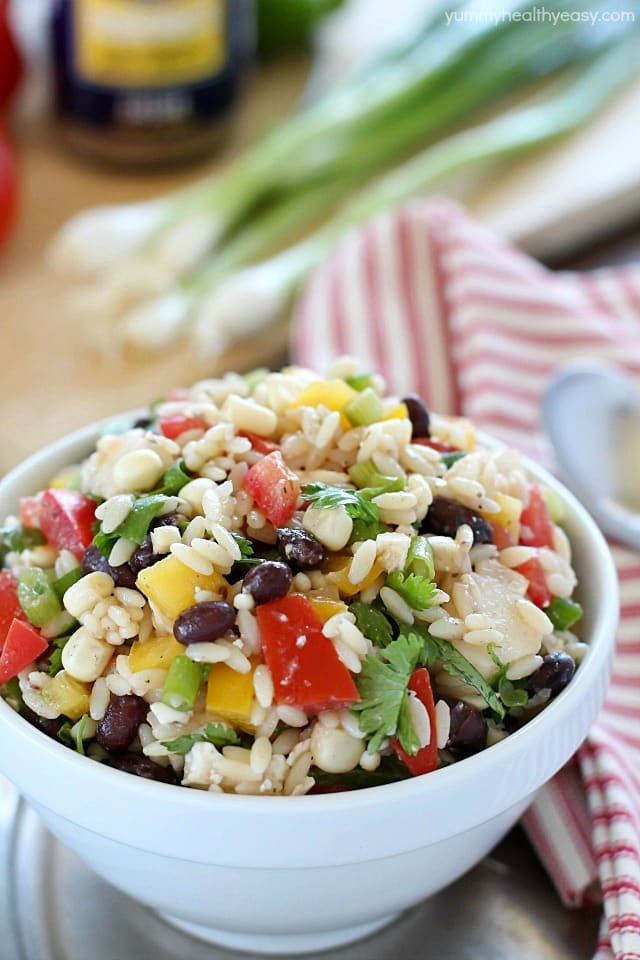 This Healthy Southwestern Orzo Salad recipe is full of veggies, black beans, orzo, & feta cheese all smothered in a delicious dressing! #ad