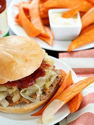 Get ready for the most flavorful spicy turkey burgers with a slathering of caramelized onions on top! Serve with a side of oven baked sweet potato fries (wedges) dipped in a spicy mayo sauce - absolutely divine! #ad