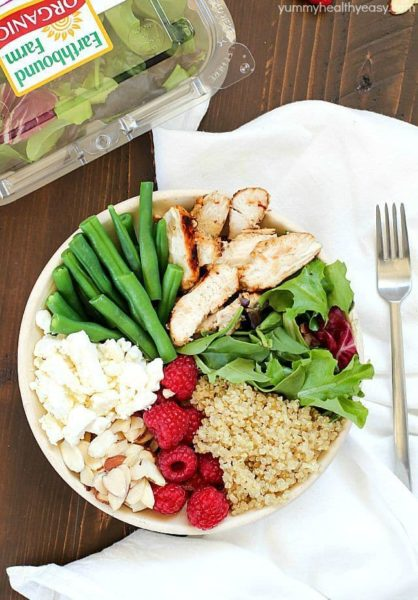 Check out this yummy salad bowl recipe full of grilled chicken, cooked quinoa, kale, raspberries, sliced almonds, feta cheese, green beans and a homemade basil vinaigrette. Super healthy and absolutely delicious! #OrganicBound #Ad