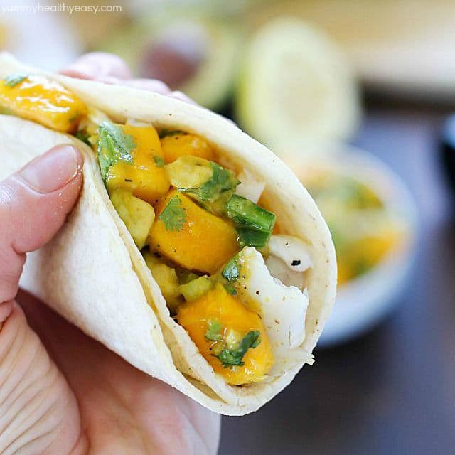 You will love these Fish Tacos with Mango Salsa! Corn tortillas filled with flaky white fish and topped with fresh mango and avocado salsa. Doesn't get better than that! #ad