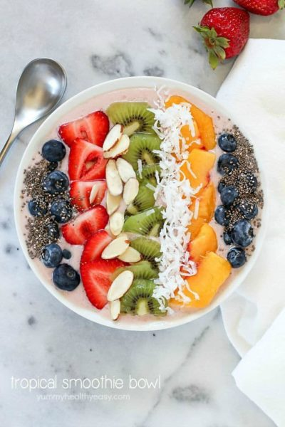 This Tropical Smoothie Bowl Recipe is the perfect breakfast or snack! It's dairy-free, gluten-free, full of protein and fresh fruit and totally delicious. Satisfying and easy to make, too! #SilkCashew #ad